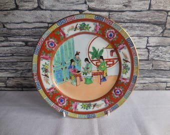 A vintage Chinese hand painted decorative plate