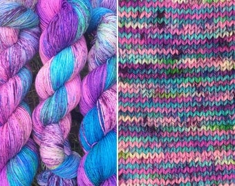Blue Raspberry, speckled indie dyed soft 75/25 merino nylon blend sock yarn