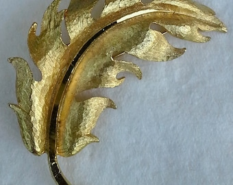 Vintage Mamselle gold plated textured ans shiny pin/brooch leaf shape