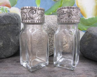Rustic style salt and pepper shakers with pewter caps
