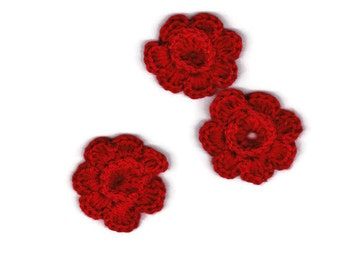 3 crocheted red flowers