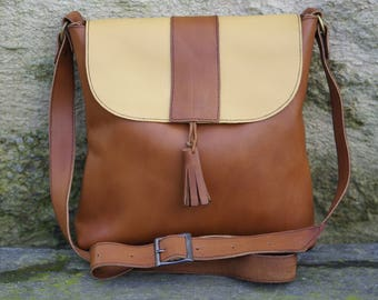 Small leather bag in Brown and yellow leather strap