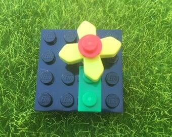 Lego flower brooch.