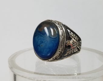 men's ring size 11 1/2  the stone is a blue with a little brown  banded agate. The ring has a t-bird on both sides and has been oxidized.