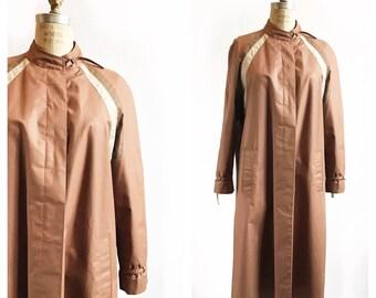 SALE 1970's mocha swing trench coat with sunburst stripes. Size M.