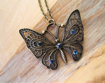 Butterfly pendant necklace. Vintage 1950's Swarovski  'Sapphire' crystals. Bronze tone hand finished