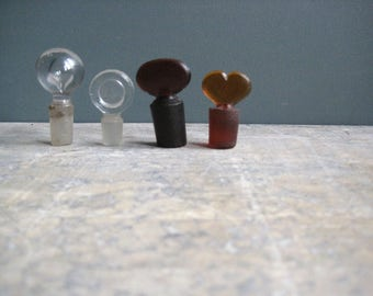 small vintage french glass bottle stoppers, bouchons, clear glass, amber glass, pharmacy bottle stoppers