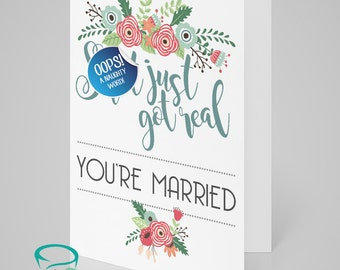 Sh*t got real! You're married  - Adult only alternative sweary wedding greetings card - blank on the inside.