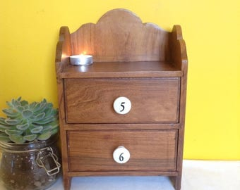 Old vintage wooden drawers. Small set of old drawers, numbered ceramic knobs.