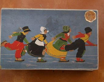 Vintage cardboard box with skaters folk style in winter