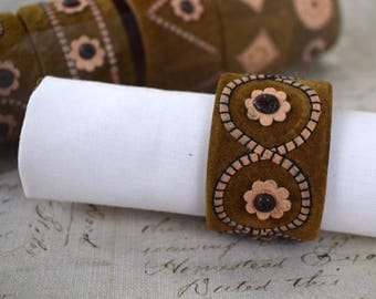 Set of six vintage suede and leather 1970's retro napkin rings
