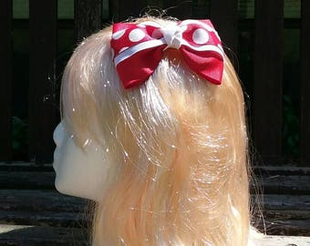 Pair of red and white with polka dots hair bows