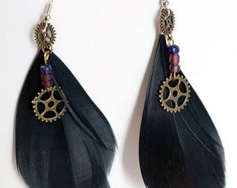 Steampunk feather earrings with cogwheels