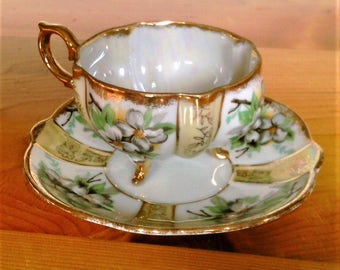 Vintage Hand painted Footed Tea Or Coffee Cup And Saucer With Dogwood Blossoms and Gold Trim