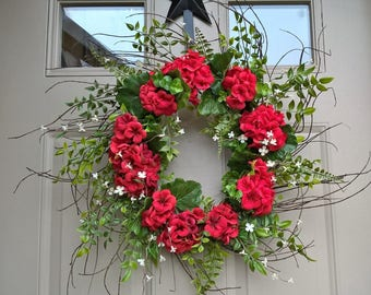 Red spring/summer geranium sunburst wreath wreath with tiny white flowers and ferns