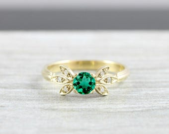 Lab created emerald and diamond engagement solitaire nature inspired leaf ring in gold handmade
