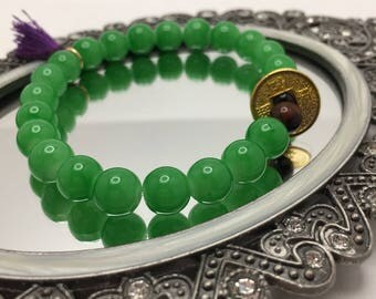 Emerald Green & Tiger's Eye Brown Beaded flexible bracelet with a brass Gold Chinese Prosperity Coin and Mini Purple Tassel. Feng Sui.