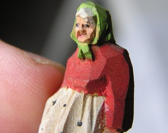 """Miniature (1 3/8"""") carving of an old woman - Quebec, signed M. Bay"""