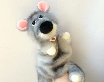 Mouse. Toy glove. Bibabo. Hand puppet. Marionette. Toy on hand. Puppet theatre.