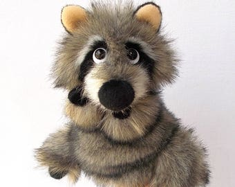 Baby raccoon. Bibabo. Puppet. Toy on hand. Marionette. Toy glove. Puppet theatre.