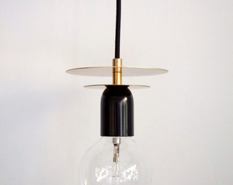 Aureola Brass Pendant light with fabric cable and brass discs