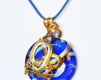 Aluminum wire, seed beads, Murano style glass pendant. LBC137
