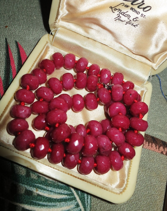 Beautiful knotted and faceted rondelle raw ruby 6 x 10  mm  necklace
