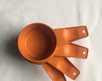 Vintage Tupperware Measuring Cups Orange. Camping cups.