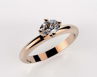 Moissanite & Rose Gold Solitaire Engagement Ring
