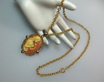 Retro Gold Tone Resin Cameo Girl with Flower Pendant Necklace on 22 Inch Chain