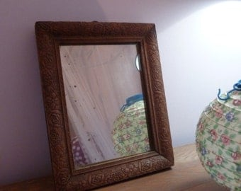 Small old carved wood mirror