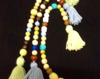 Beaded Tassle.   Coloured wool and beads.