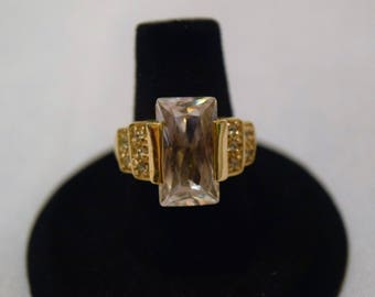 Gold Ring with White Rectangle Gem
