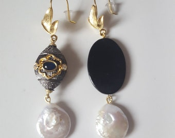 Handmade brass earrings with horn and pearl.