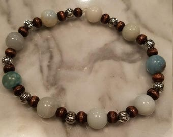 Handmade Beaded Bracelet, blue and white stones, wood, and metal.