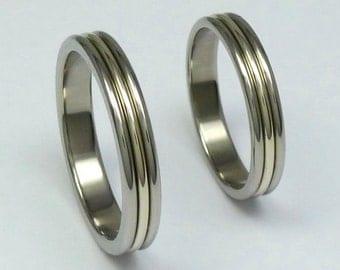 Pair of polished titanium and 14 carat white gold weddingrings, engagementrings. Titanium white gold rings.