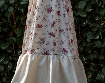 Ivory and floral satin gown, bonnet and shoes.