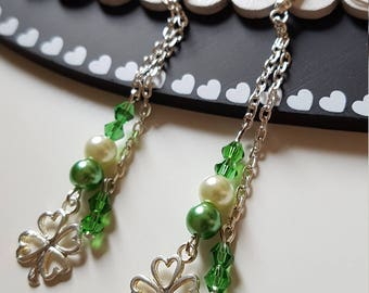 Dangling earrings with four leaf clover-shaped pattern