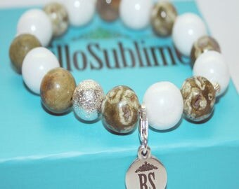 Fine and elegant bracelet white agate treated and rhyolite stone with entrepiezas and 925 sterling silver charms