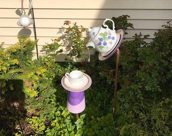 purple berries tea pot bird feeder