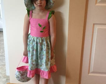 A girls summery dress with hat and purse