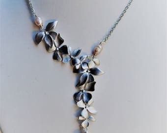 Necklace cascade of silver orchids and freshwater pearls, wedding, handmade model