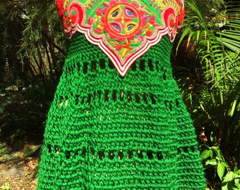Green crocheted cross-over mini dress with embroidered brilliant colour panel