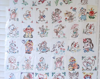 Gorgeous embroidered quilt top - 40 squares - animals, nursery rhymes and clowns - unfinished