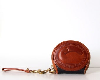 Vintage 80s DOONEY And BOURKE Giant Logo Change purse All Weather Leather Wristlet