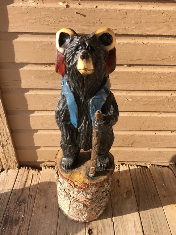 Backpacking bear chainsaw carving