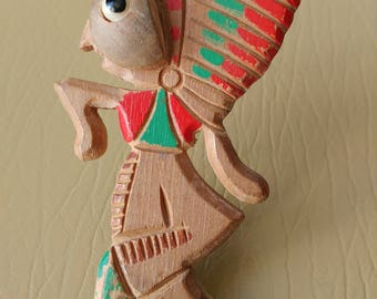 "Handcarved and painted wooden ""native"" in headdress novelty brooch"