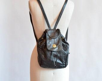 Vintage 1990s black LEATHER mini backpack