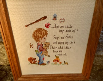 Sampler cross stitched sampler framed What are little boys made of? Snips and Snails and puppy dog tails, that's wha little boys are made of