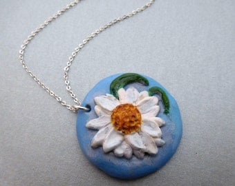 Daisy clay pendant - 3D daisy picture, sculpted relief round pendant hung on silver chain, white flower blue background polymer clay jewelry